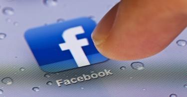 Hong Kong,China - July 2, 2011: Macro image of clicking the Facebook icon on an iPad screen